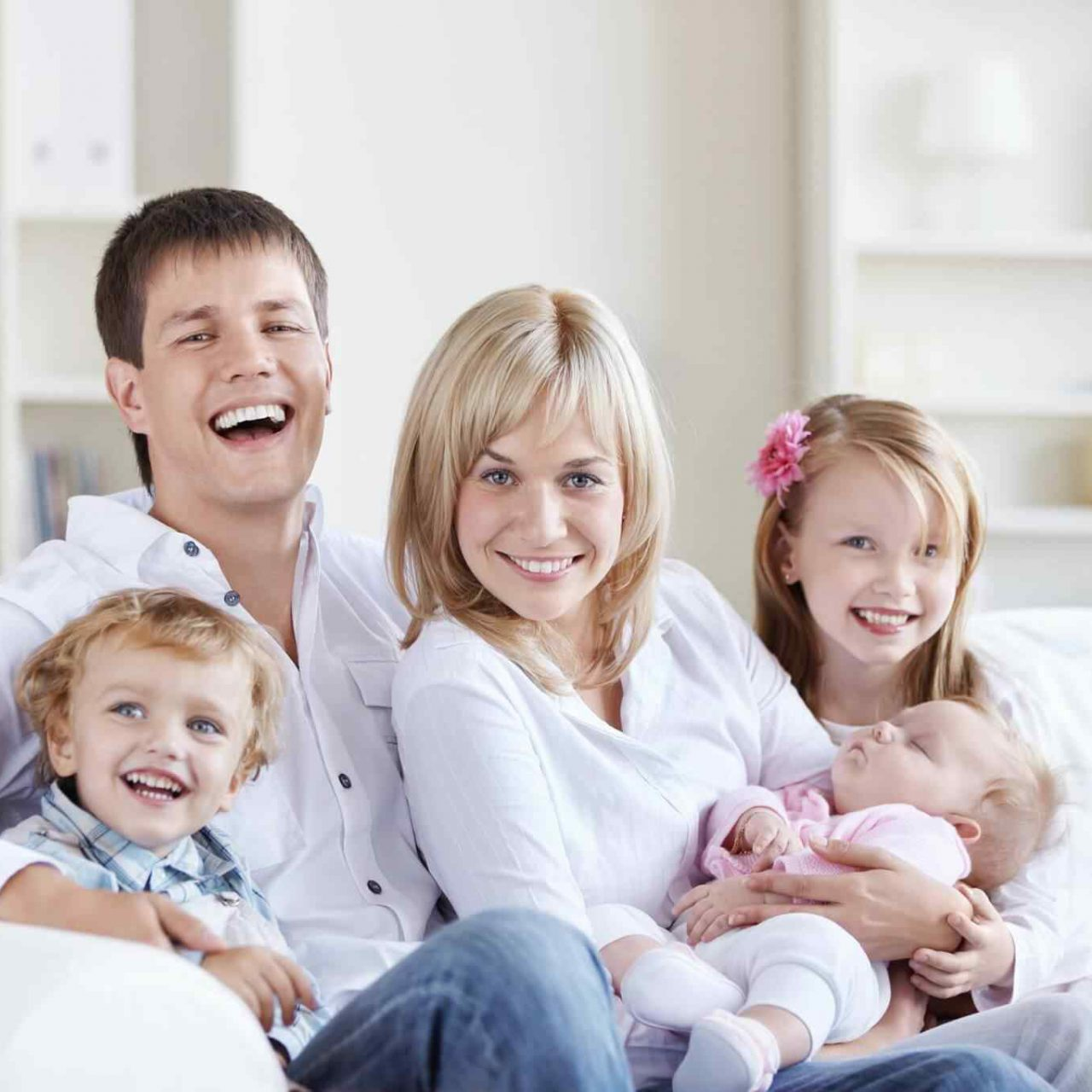 A happy family with three children at home